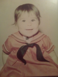 This is me at age 1. I couldnt' find a picture of me at age 5. But I was cute. Trust me.